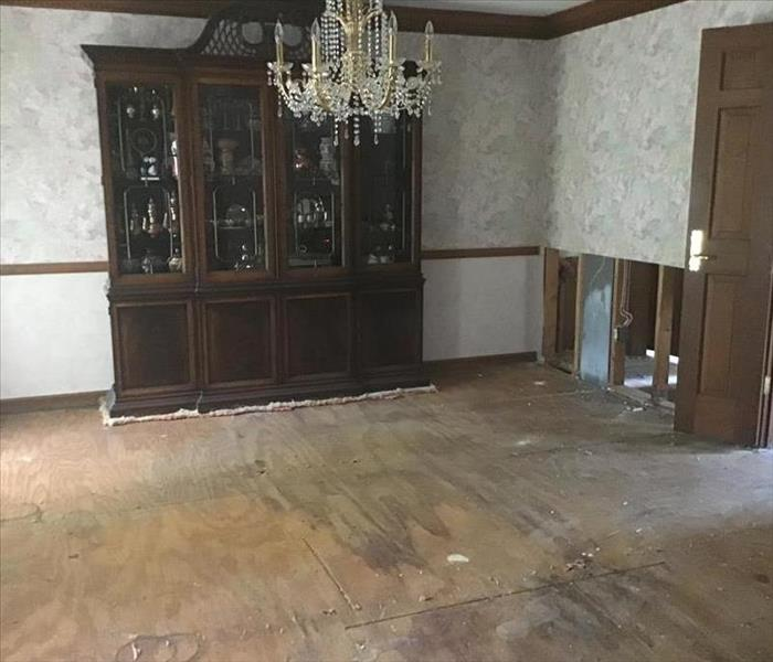 carpet removed in dining room after water damage