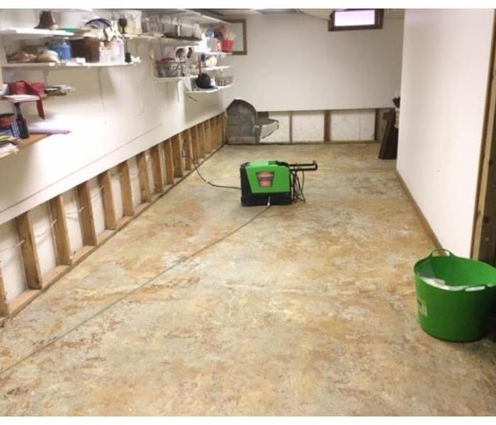 carpet removed and equipment set after water loss