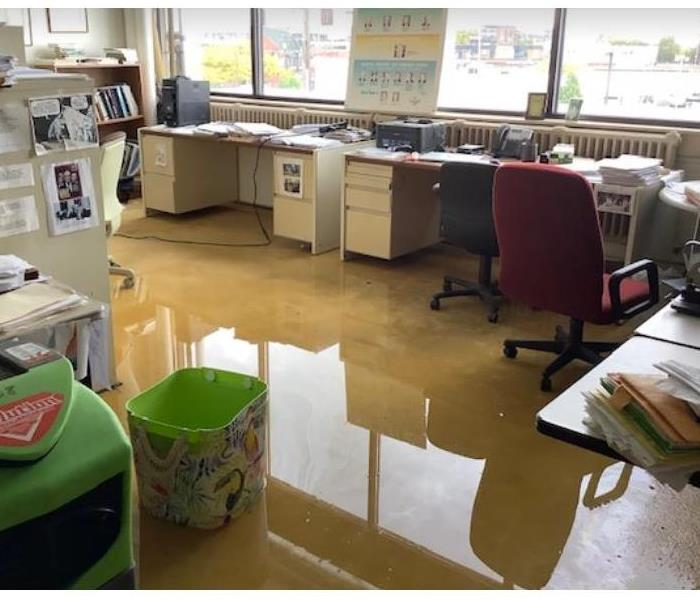 standing water on concrete floor of office
