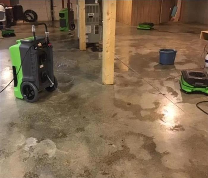 equipment set on concrete floor of basement
