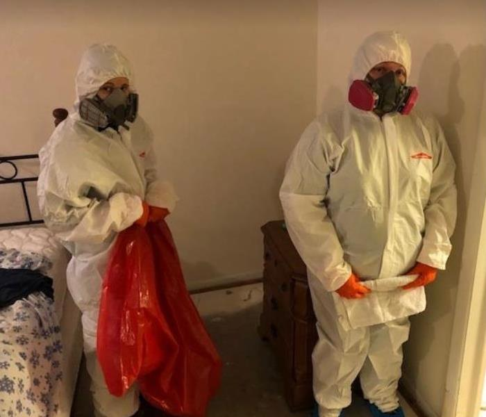 employees in ppe to clean biohazard