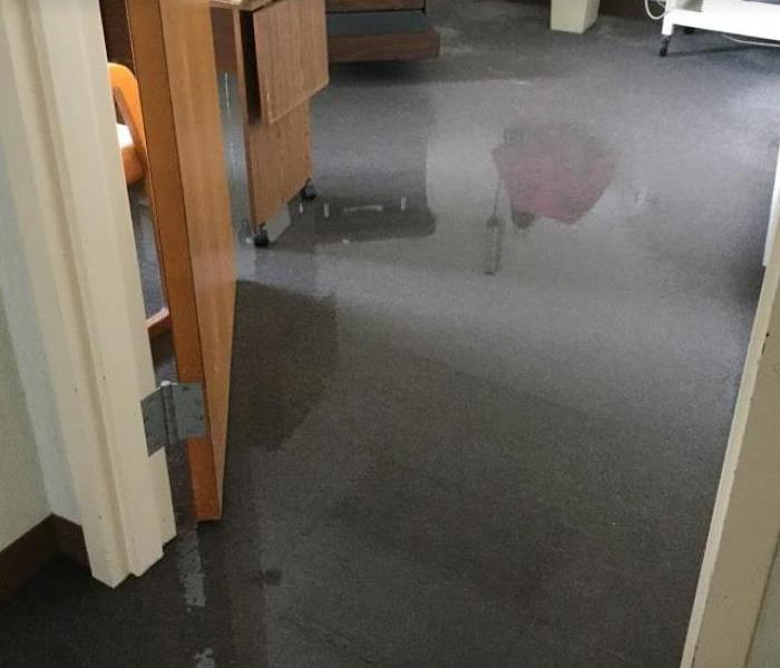 water on floor of commercial building