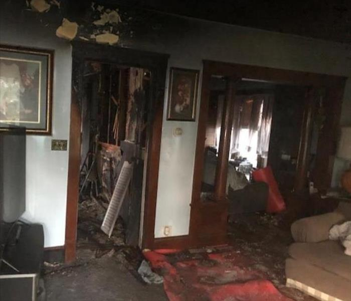 soot and fire damaged walls in living room