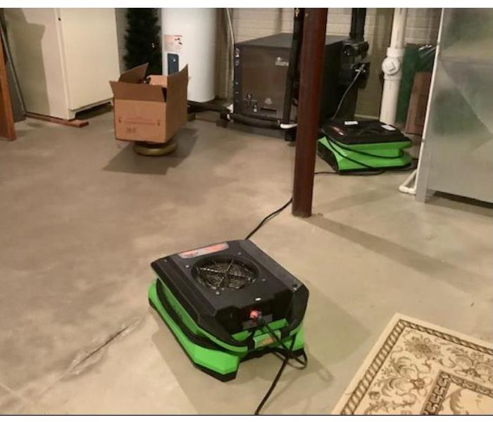 equipment set on concrete floor in basement after water back up