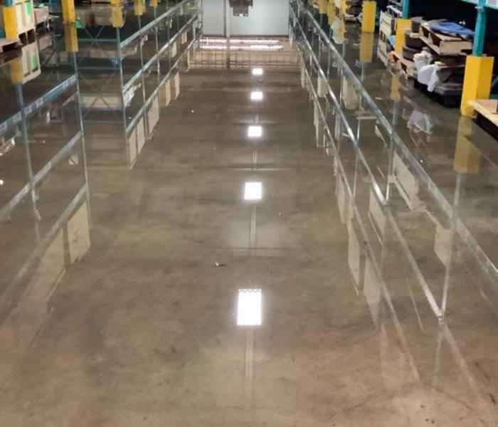 water on concrete floor of warehouse